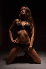 girl in lingerie on knees