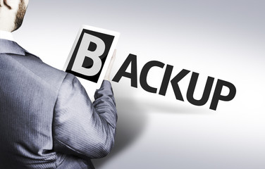 Business man with the text Backup in a concept image