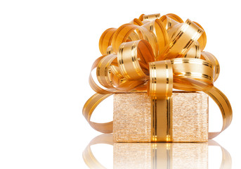Beautiful  Gift box in gold wrapping paper isolated on a white b