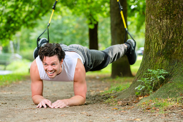 man doing suspension trainer sling sport