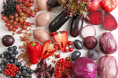Leinwandbild Motiv Fresh organic vegetables on wooden table, close up