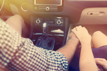 Young couple sitting in car