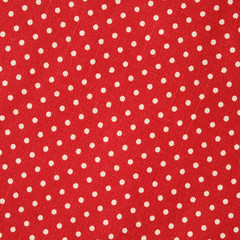Polka dot on red canvas cotton texture, fabric background