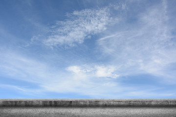 concrete ground with cloudy sky