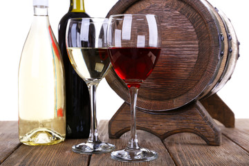Wine in goblets and in bottles and wooden barrel