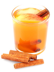 Apple cider with cinnamon sticks, isolated on white