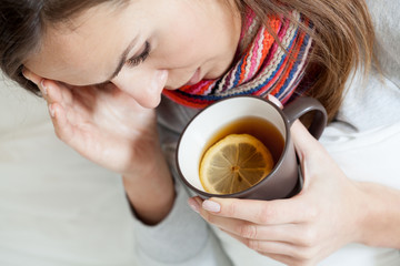 Ill woman drinking tea