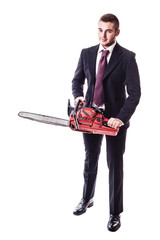 Businessman holding a chainsaw