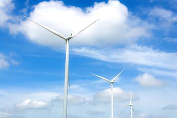 Wind turbine on the  blue clouded sky