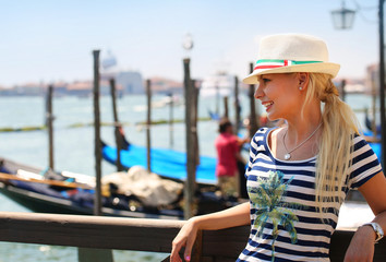 Happy Tourist and Gondolas in Venice, Italy. Cheerful Blonde