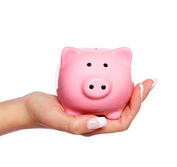Piggy Bank in Female Hand isolated