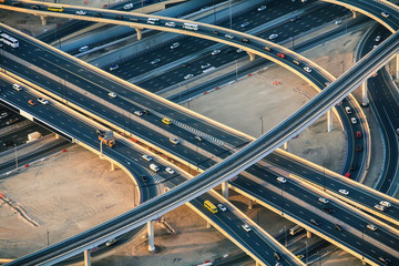 Highway roads with traffic in big city (Dubai) viewed from sky