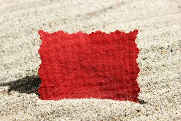 Blank Red Message Note Card in Sand