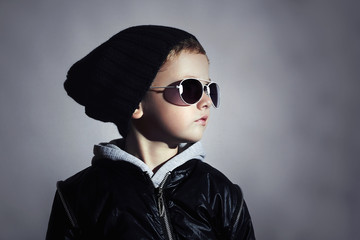 Fashion child boy in sunglasses.Underground background.boy