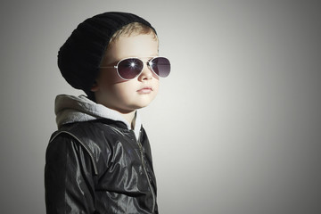 child in sunglasses.winter style.Little boy.Children fashion