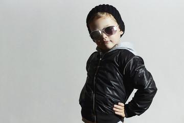 posing child in sunglasses.winter style boy.Children fashion