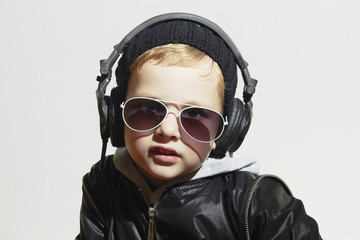 funny boy in sunglasses.little deejay listening music