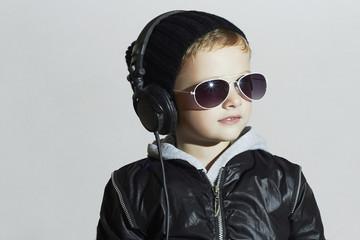 little boy in headphones.child listening music deejay
