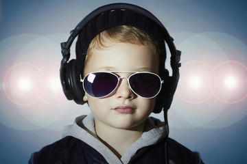 child little deejay.boy in sunglasses and headphones.disco