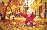 Fototapety happy little child, baby girl laughing and playing in autumn