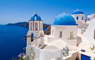 Oia Orthodox churche and the bell tower on Santorini, Greece.
