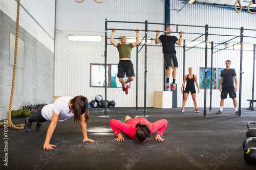 Tuinposter Gymnastiek Athletes Exercising In Gym