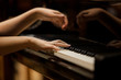 Woman's hands on the keyboard of the piano closeup - 70978614