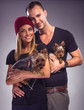 Loving couple with two yorkshire terrier dogs
