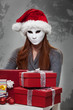 Woman in White Mask with Christmas Gift Boxes
