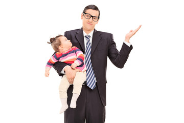 Carefree businessman holding his daughter