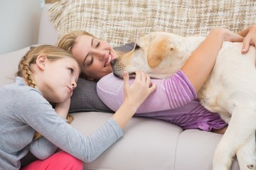 Mother and daughter with pet labrador
