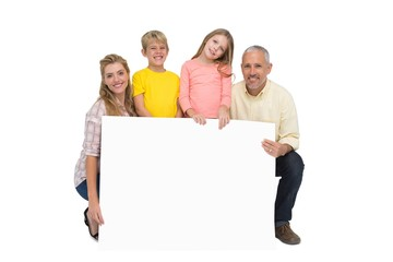 Happy family showing white card