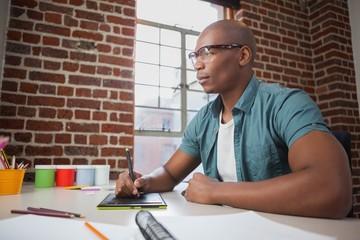 Designer sketching on graphics tablet