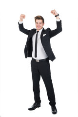 Portrait Of Successful Businessman With Arms Raised