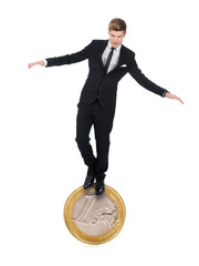 Businessman Balancing On One Euro Coin