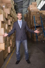 Portrait of serious manager in warehouse
