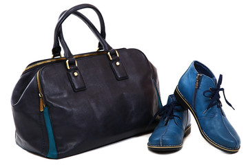 Modern women's fashion footwear and bag against white background