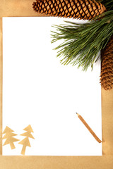 Pine branch with cones, paper and pencil. Concept congratulation