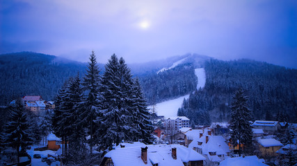 Winter evening in a mountain village