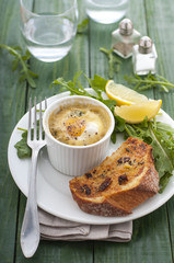 Baked egg with salad and bread