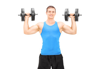 Strong male bodybuilder exercising with barbells