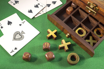 Cards with tic-tac-toe in wooden box
