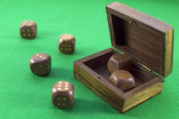 Dice close up on green background