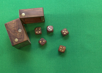 Dice in box on green background