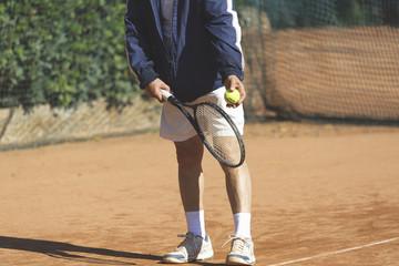 Giocando a tennis