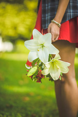 Woman carrying  a bouquet of flowers