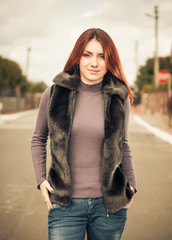 redhead woman in waistcoat at uptown street
