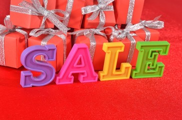 Sale written by colorful letters and gifts