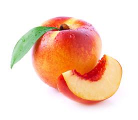 Ripe peach with leaf.