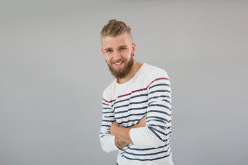 Portrait of young trendy guy with stiped shirt